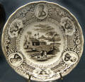 Campaign log cabin plate ringed by W.H. Harrison portraits at Grouseland. Vincennes, IN.