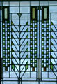 Detail of Tree of Life stained glass window by Frank Lloyd Wright from Darwin D. Martin House, Buffalo at Corning Museum of Glass. Corning, NY.