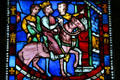 Stained glass shows Theodosius arriving at Ephesus from legend of Seven Sleeping Christian Brothers from cathedral in Rouen, France at The Cloisters. New York, NY